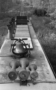 2021.008.4.001--clint jones 6x9 neg--COPR--view of roof of BLW diesel locomotive ready to depart with freight train--McKeever MI--1960s. Bell was re-used off steam locomotive of same number.