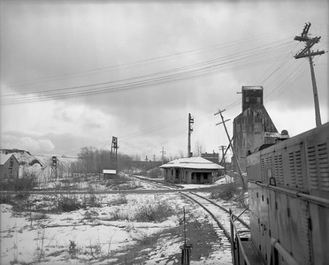 2021.008.4.045--clint jones 4x5 neg--COPR--view from locomotive cab approaching depot--Painesdale MI--1960s