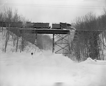 2021.008.4.042A--clint jones 4x5 neg--COPR--Russell snowplow plowing snow southbound crossing bridge 14--one mile south of Houghton MI--no date