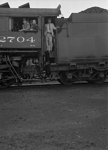 2010.004.111--clint jones collection PC neg [virgil g jackson]--SOO--steam locomotive 4-6-2 2704 with fans in cab--N Fond du Lac WI--1940 0600