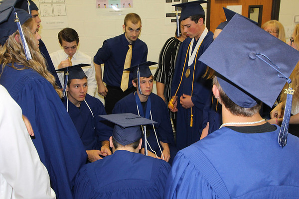 SHERRY VAN ARSDALL | THE GOSHEN NEWS<br /> Nine seniors at Clinton Christian School in Goshen prayed with members of the junior class before the commencement ceremony Friday evening.