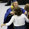 SHERRY VAN ARSDALL | THE GOSHEN NEWS<br /> Valedictorian Myka Shetler gives a rose to a family member during the 50th annual commencement ceremony for the class of 2017 at Clinton Christian Church in Goshen Friday evening.