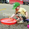 Matthew Dermody, 1, of Fulton, Ill., scoops bubbles out of a saucer during Felix Adler Day on June 30 at the Children's Discovery Center. Almost 2,000 people attended the event and more than 100 volunteers assisted in the day-long festival. In addition, 16 cities in Iowa and 18 cities in Illinois were represented, along with five other states. • Scott Levine/Clinton Herald