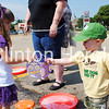 Elizabeth Grinnall, 3, of Clinton, hands off a bubble tool to Matthew Dermody, of Fulton, Ill., during Felix Adler Day on June 30 at the Children's Discovery Center. Almost 2,000 people attended the event and more than 100 volunteers assisted in the day-long festival. In addition, 16 cities in Iowa and 18 cities in Illinois were represented, along with five other states. • Scott Levine/Clinton Herald