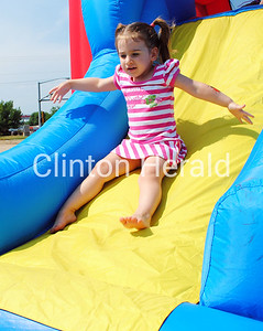Sadie Johnson, 3, of Clinton, rides down the slide at Felix Adler Day on June 30 at the Children's Discovery Center. Almost 2,000 people attended the event and more than 100 volunteers assisted in the day-long festival. In addition, 16 cities in Iowa and 18 cities in Illinois were represented, along with five other states. • Scott Levine/Clinton Herald