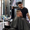 """Geno Neagle gets his hair cut for the second time at Clippers & Co. by Brian Martinez on Wednesday afternoon. When neagle was asked what he thought of the new barber shop he said """" I Love It."""" SENTINEL & ENTERPRISE/JOHN LOVE"""