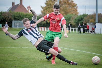 Greg Kidd just beaten to the ball in the Clipstone penalty box with a well timed challenge by the defender.