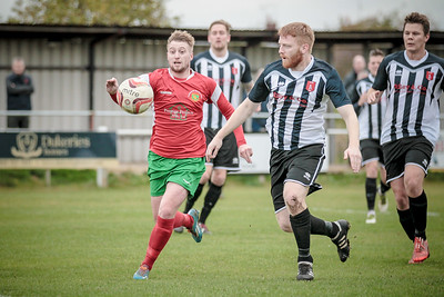 Another panic in the Clipstone penalty box as Chris Ovington bears down on the bouncing ball.
