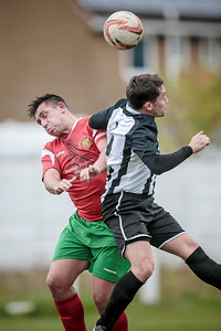 Player/manager Beesley wins another header in the midfield.