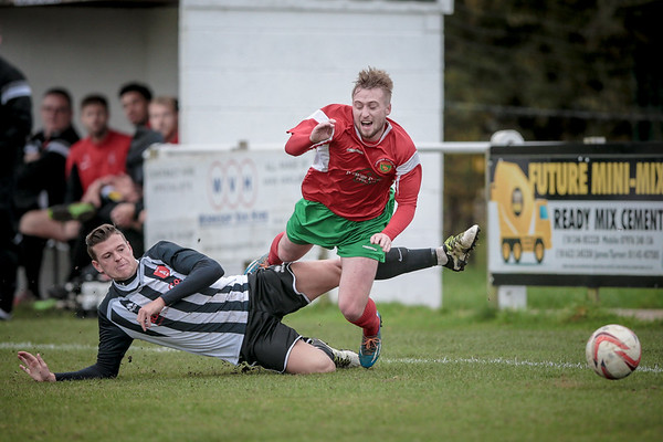 Chris Ovington brought unceremoniously down on the right wing during the first half.