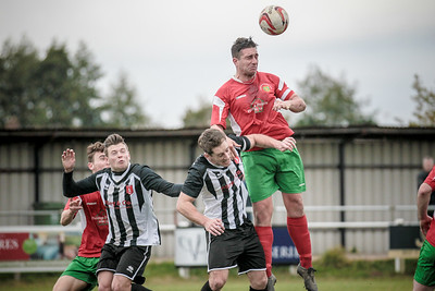Paul Beesley wins the header from a Railway corner, to head back across the box.