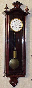 This Austrian clock with Granne Sonnerie strike has a case that is in truly beautiful condition. And, at 33 inches, it is very small and very attractive. Best of all this clocks case is complete, right down to original finials and all the bits of trim. And while the side glass is slightly wavy, the door glass appears to be later. This clock maintains the relatively narrow body of earlier clocks, giving it the grace of the Biedermeier and the Transitional clocks, though its size is difficult to grasp from these pictures. I find each time that I receive clocks from Austria that the ones that give the biggest surprises are the miniatures - the pictures never give me a good feeling for how small they really are. <br /> <br /> I can not make out the name of the maker on the dial, though the town is very clearly Steyr, which is 90 miles west of Vienna. I included a couple of pictures of the mechanism to give some idea of what a beautiful and small mechanism this clock has while the case has been cleaned and waxed, the mechanism could use a good cleaning. It really is a very fine mechanism, and has the kind of attention to detail you come to expect from a provincial clock. Note the separate gong-mount that attaches to the wooden seat board - one of the trademarks of an early clock. The dial is complete, with no chips, but a number of hair-line cracks.  These very fine cracks will virtually disapear when the dial is cleaned.  The pendulum bob (brass backed!) and rod are perfect, as is the weight. <br /> <br /> Length - 33 inches <br /> Wall Stabilizers - Old Brackets, New Screws <br /> Case Condition - 1 <br /> Winding Key - New  <br /> Mechanism - Awaits restoration  <br /> Mechanism Mount - Wooden Seat board  <br /> Pendulum - Brass back <br /> <br /> This clock, like most 2 spring, 1 weight Austrian clocks, runs for roughly 2 days per wind.  If interested, give me a call and I can explain the origin of the Viennese 2 day clocks.<br /> <br /> This clock would be yours for $2,450, ready to hang on your wall and enjoy.  This wouldl include the restoration of the mechanism and delivery in the lower 48.