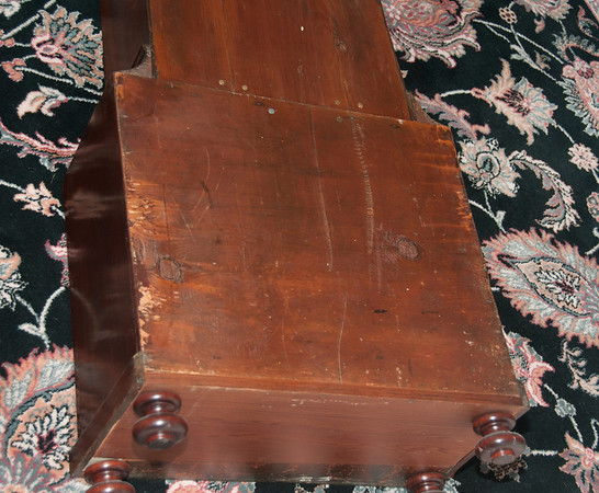 As is not uncommon in British tall-case clocks, the base was in fairly poor condition when I bought this piece.  I have laid in a new piece of wood to the back of the very bottom, and turned 4 bun feet to duplicate the form of the part of one original foot that was in the base of the clock when I bought it.  <br /> <br /> The case is very solid and has shown no signs of any additional cracking or shifting in the 10 years since I cleaned up the case.