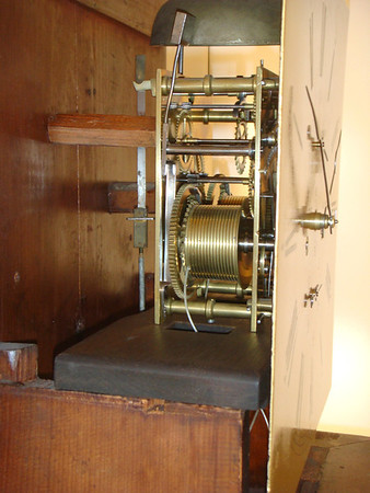 When I bought this clock at auction it had a very rough and very warped seatboard.  I replaced the seatboard with a piece that reflects the originals shape.  Note that the mechanism is held to the seatboard by two screws through the lower mechanism posts - you can just see a bit of the screw from this side, and the top of the hole in the post.  Again, a very unusual arangement for a British Tall-case clock, reflecting both the individuality of the maker and the distance from Londons stifling influence.