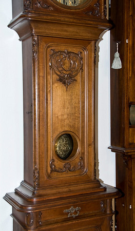 I always have liked the floor-standing clocks with the lenticular window in the bottom of the trunk door.  This allows you to see the pendulum swinging even with the door closed.