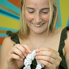 Chloe Dewhurst, 19, of Lancaster and a student at Springfield college has started a scrunchie business out of her bedroom. She calls her company BBE Scrunchies (Brave Bold Energy). Dewhurst shows how she makes them in her bedroom in Lancaster. SENTINEL & ENTERPRISE/JOHN LOVE