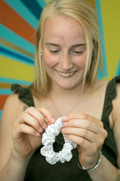 . Chloe Dewhurst, 19, of Lancaster and a student at Springfield college has started a scrunchie business out of her bedroom. She calls her company BBE Scrunchies (Brave Bold Energy). Dewhurst shows how she makes them in her bedroom in Lancaster. SENTINEL & ENTERPRISE/JOHN LOVE