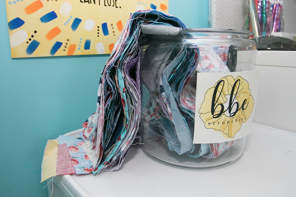 . Chloe Dewhurst, 19, of Lancaster and a student at Springfield college has started a scrunchie business out of her bedroom. She calls her company BBE Scrunchies (Brave Bold Energy). Some fabric on her desk waits to be made into scrunchies. SENTINEL & ENTERPRISE/JOHN LOVE