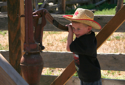 4595 Little Cowboy pumping water