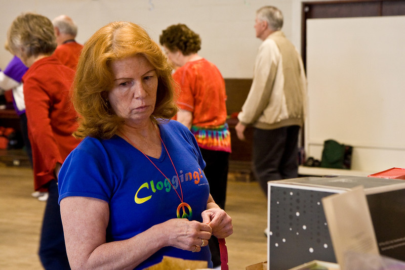 Carol checking out raffle prizes