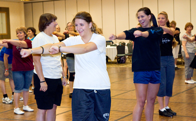 """Chris, Dana, and Amanda doing Jeff Driggs' """"Megablast"""" in the workshop"""