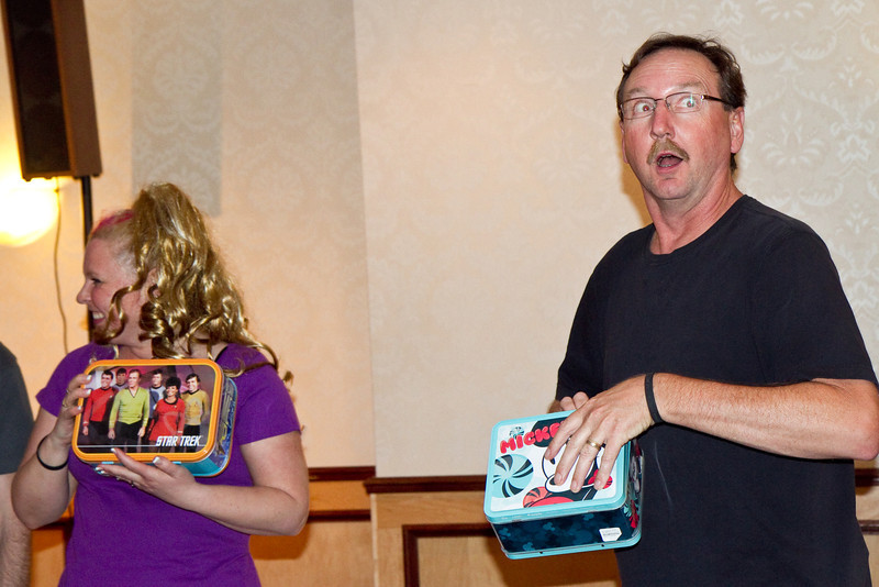 Russ Hunsaker about to reveal the prize inside the lunchbox he's holding.