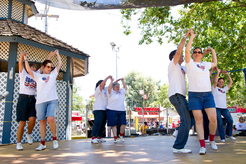 """Clogging Express dancing """"Dance Above the Rainbow"""" at the Alameda County Fair."""