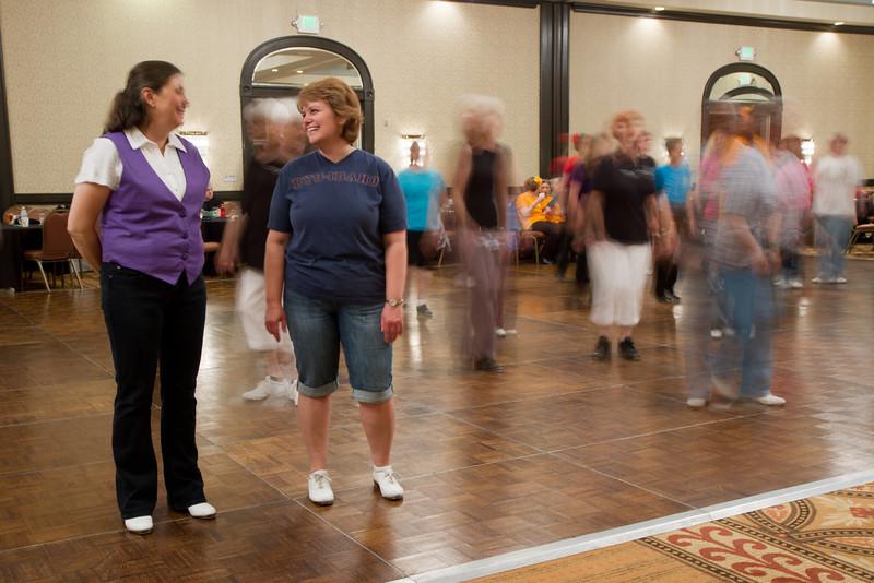 Carol and Annie and blurred dancers.