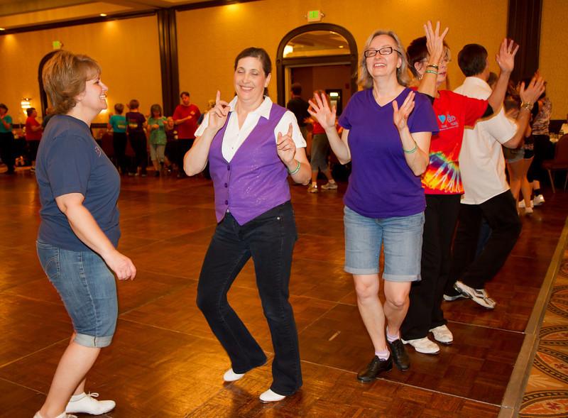 Annie, Carol, Sheila, and Bonni dancing the Hokey Pokey