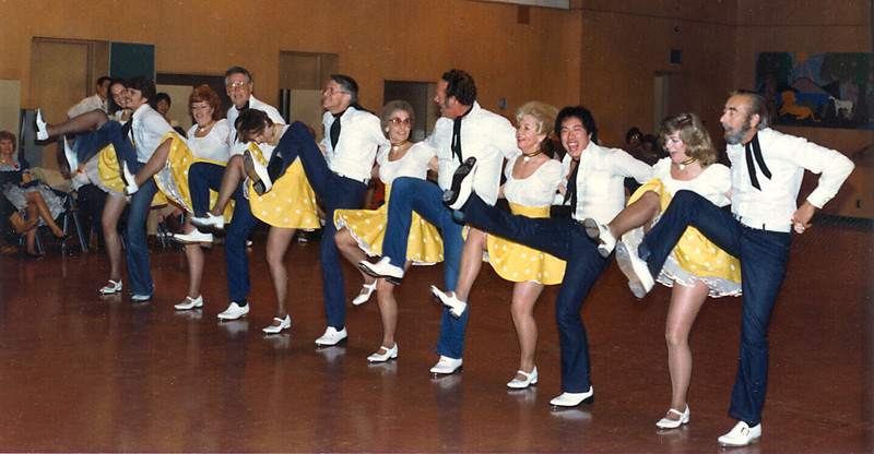 The Diablo Mountain Cloggers performing at the U.C. Squares dance in January, 1982. L to R: Vera, Tim, Wanda, Bill, Julie, OJ, Bobbie, Darrel, Bunny, Doug, Pam, Dave.