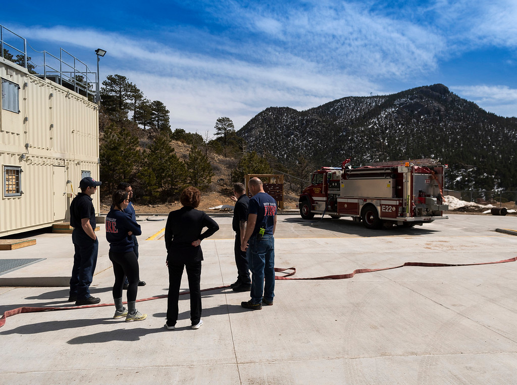 . Fire crews prepare for a live burn demonstration at the Estes Valley Fire Protection District training facility.