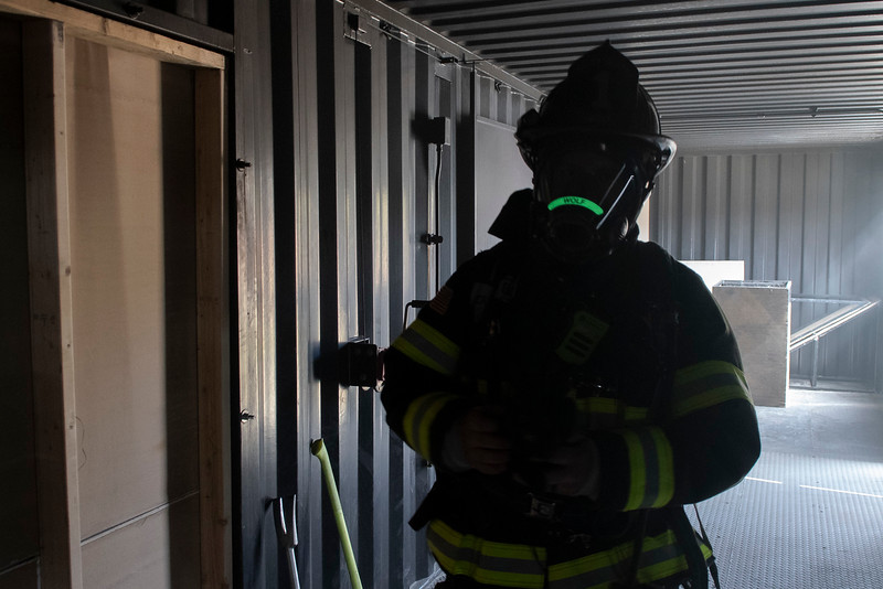 Estes Valley Fire Chief David Wolf walks the media through safety precautions of being inside a controlled house fire.
