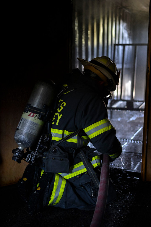 . Paul Capo extinguishes the fire.