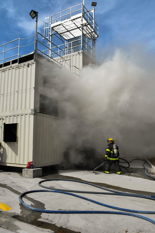 . Smoke billows out of the Estes Valley Fire training facility during a live burn demonstration.