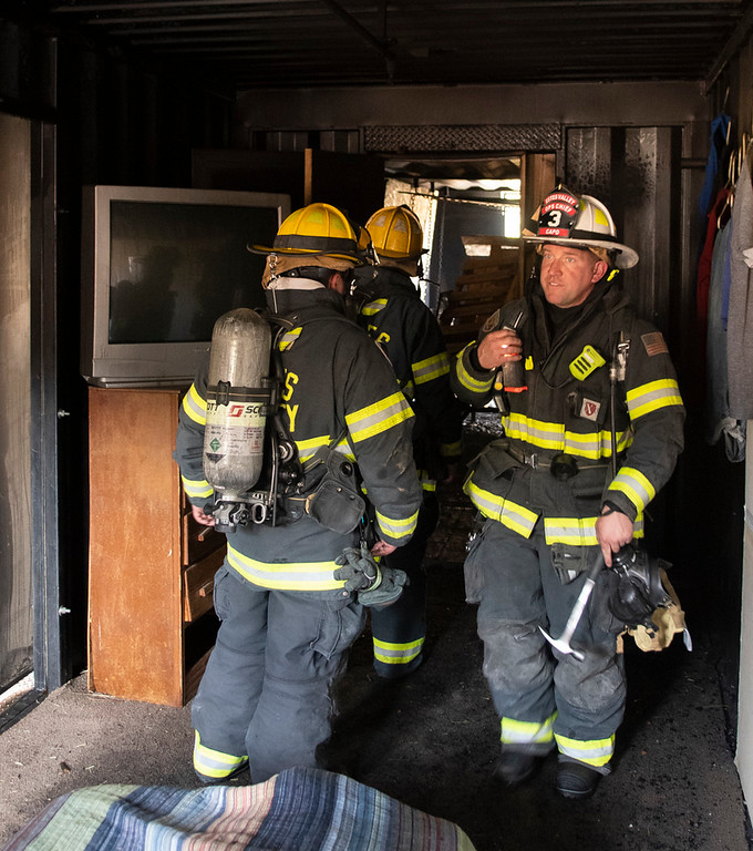 . Paul Capo inspects the bedroom following the first of two controlled fires.