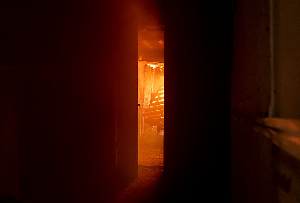 . On the other side of the bedroom door, fire scorched wood pallets before making it�s way into the bedroom.