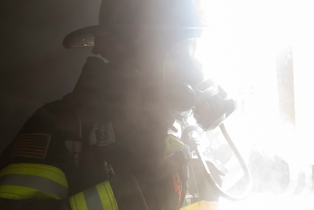 . Paul Capo gets ungulfed in smoke as the fire enters the bedroom where a human dummy is sleeping.