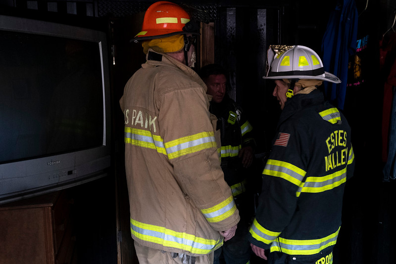 Fire Marshal John Jerome walks fire crews through the damage that occured during the first of two controlled fires to show the efficacy of a closed bedroom door in saving lives during a controlled burn.