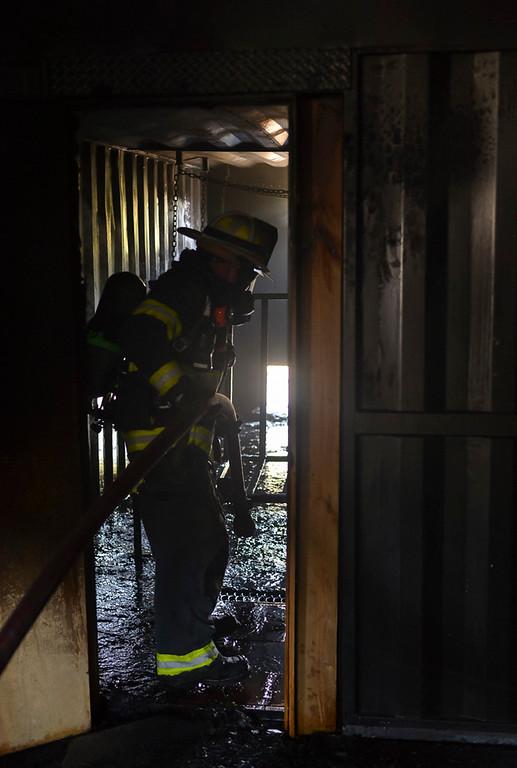 . Paul Capo prepares to spray down the fire room.