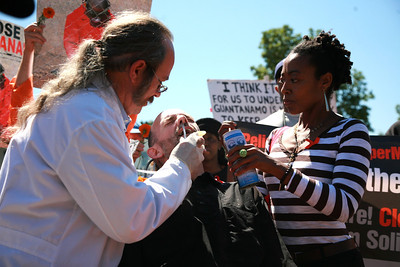 After fasting on water-only for 61 days in solidarity with hunger striking prisoners north and south, Andrés Thomas Conteris was forced fed in front of the White House with nasogastric tubes to show how prisoners are force-fed twice daily in Guantánamo.  9/6/13