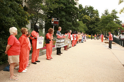 Art Laffin of the D.C. Catholic Workers leads protest/vigil outside of hearing on Capital Hill to close Guantanamo.