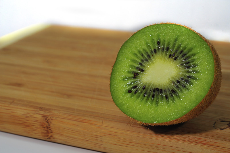 Kiwi Slice on Cutting Board
