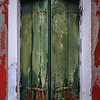 Shutters on window on red house in Burano, Italy