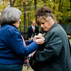 """Gold Star Wife Valorie Reed receives a pin during a presentation by the Daughters of the American Revolution at Carter Park during the final day of """"The Wall That Heals"""" in Leominster on Saturday afternoon. SENTINEL & ENTERPRISE / Ashley Green"""