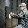 "Stephen Weaver finds the name of a relative, Barry Kent Weaver, at Carter Park during the final day of ""The Wall That Heals"" in Leominster on Saturday afternoon. SENTINEL & ENTERPRISE / Ashley Green"