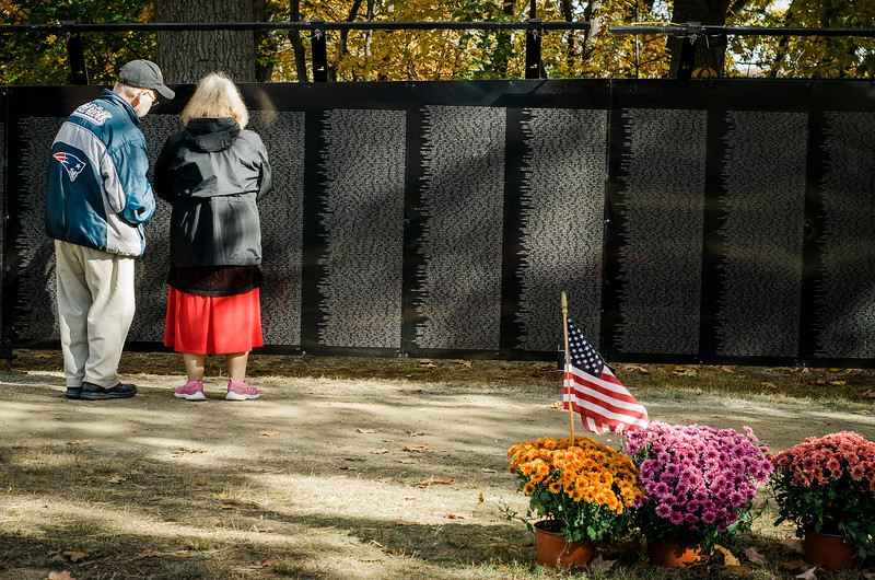 "Guests look for names at Carter Park during the final day of ""The Wall That Heals"" in Leominster on Saturday afternoon. SENTINEL & ENTERPRISE / Ashley Green"