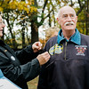 """Army veteran Alton Bauckman receives a Vietnam Veteran pin at Carter Park during the final day of """"The Wall That Heals"""" in Leominster on Saturday afternoon. SENTINEL & ENTERPRISE / Ashley Green"""