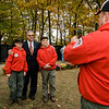 "Volunteers from Boy Scout Troop 151 Jacob Walls, 12 and Ben Stanley, 12, take a photo with Mayor Dean Mazzarella at Carter Park during the final day of ""The Wall That Heals"" in Leominster on Saturday afternoon. SENTINEL & ENTERPRISE / Ashley Green"