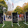 """Spectators walk around Carter Park during the final day of """"The Wall That Heals"""" in Leominster on Saturday afternoon. SENTINEL & ENTERPRISE / Ashley Green"""
