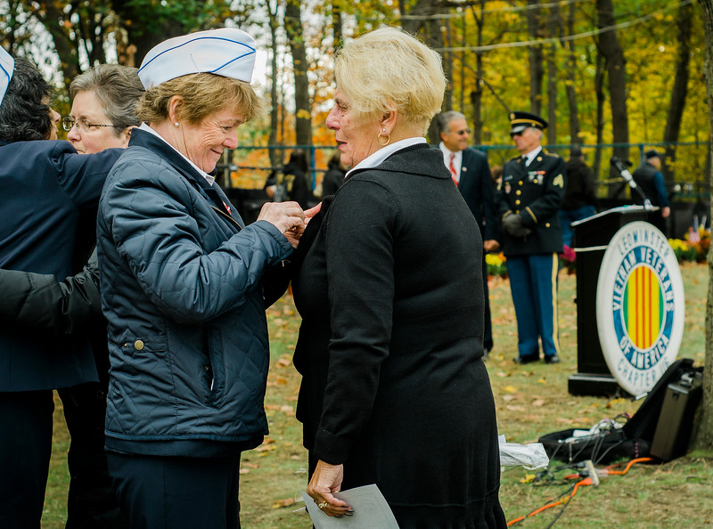 """Gold Star Wife Linda Vezina receives a pin during a presentation by the Daughters of the American Revolution at Carter Park during the final day of """"The Wall That Heals"""" in Leominster on Saturday afternoon. SENTINEL & ENTERPRISE / Ashley Green"""